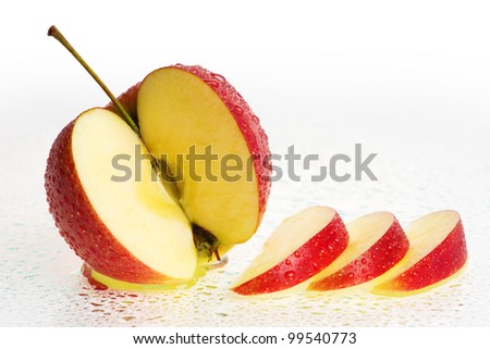 Fresh Apple Fruits with slices and Water drops. fruits after rain. - stock photo