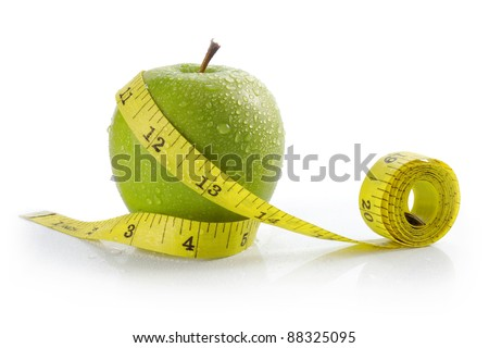 fresh apple with measuring tape. diet concept, loss weight - stock photo