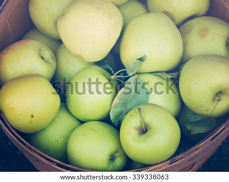 Fresh apples at the local farmers market. Farmers markets are a traditional way of selling agricultural products. - stock photo