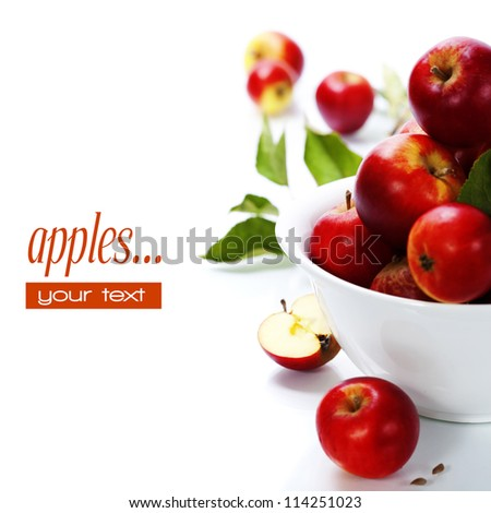 Fresh apples in a bowl over white. With easy removable sample text - stock photo