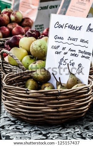 Fresh apples in baskets on display at a farmer's market - stock photo