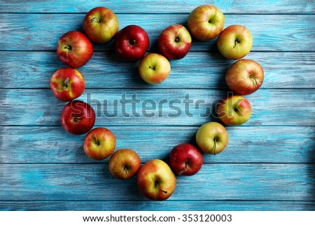 Fresh apples on a blue wooden table - stock photo