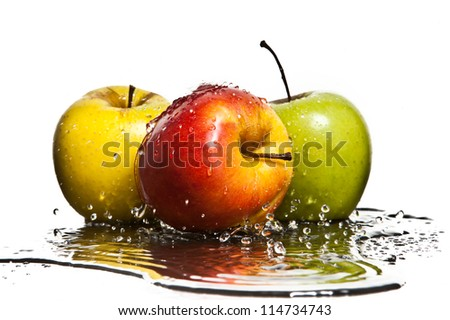 Fresh apples with water droplets and splashes - stock photo