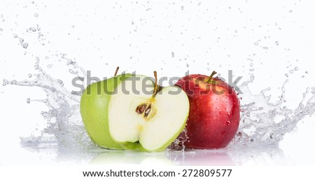 Fresh apples with water splash over white background - stock photo