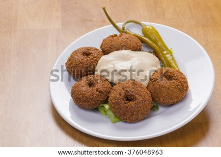 fresh arabian falafel with yogurt sauce - stock photo