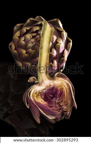 Fresh artichoke isoalted on black background. Culinary healthy vegetable eating.  - stock photo