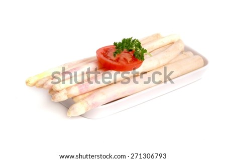 fresh asparagus isolated on white, with tomato  - stock photo