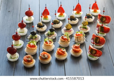 Fresh Assorted snacks of canape on the table - stock photo
