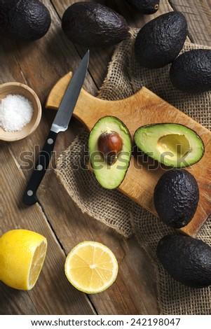 Fresh avocado and lemon.  - stock photo