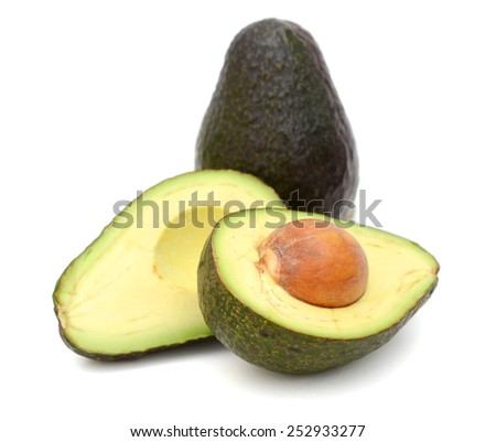 fresh avocado and slices cut isolated on white - stock photo