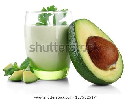Fresh avocado smoothie isolated on white - stock photo