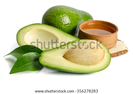 fresh avocado with avocado oil in the wooden bowl isolated on white background - stock photo