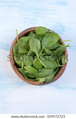 fresh Baby Spinach in a bowl close up - stock photo
