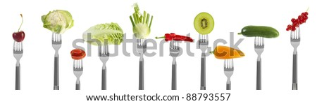 fresh baby vegetables and fruit on forks, isolated on white - stock photo