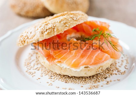 fresh bagel with cream cheese and salmon - stock photo