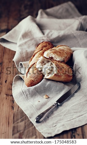 Fresh Baguette on a Linen Napkin - stock photo