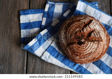 Fresh baked bread, on wooden background - stock photo