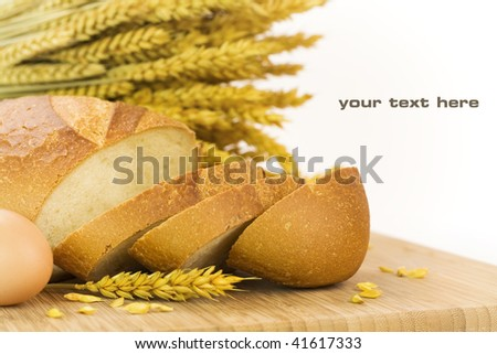 fresh baked bread sliced and grains over white background. With sample text - stock photo