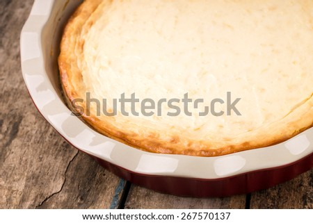 Fresh baked cheesecake on wooden table. Restaurant menu background - stock photo