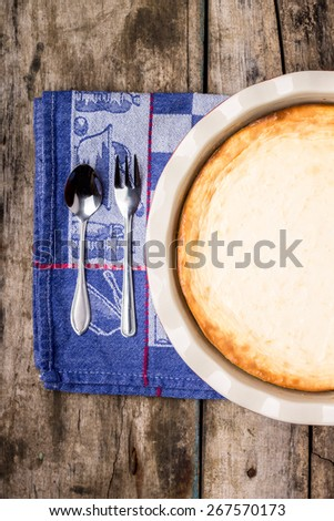Fresh baked cheesecake on wooden table with spoon and fork. Healthy eating background. Top view image - stock photo