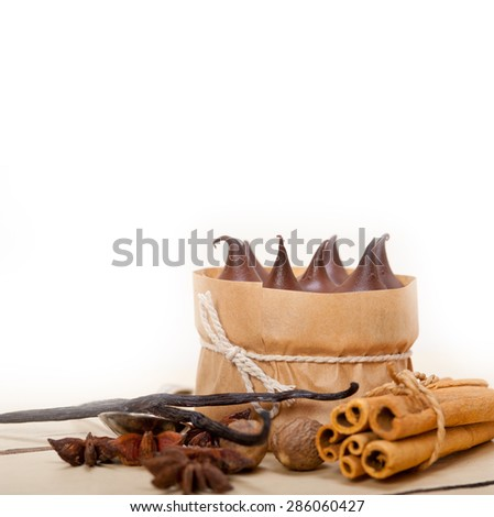 fresh baked chocolate vanilla and spices cream cake dessert over rustic wood table - stock photo