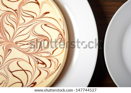 fresh baked classic Cheese cake with chocolate topping  - stock photo