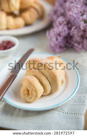 Fresh baked croissants with strawberry marmalade  - stock photo