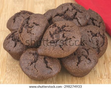 fresh baked mini chocolate muffins - stock photo