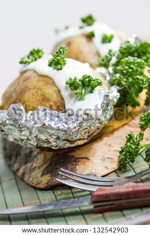 fresh baked potatoe with sour cream - stock photo