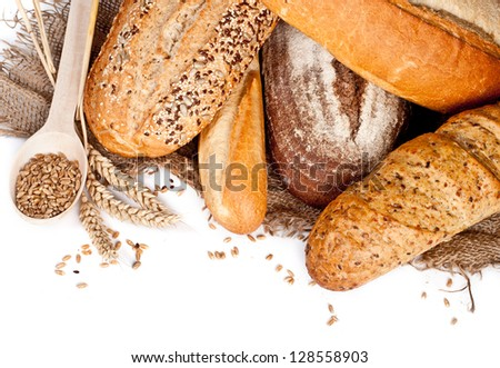 Fresh baked traditional bread and wheat - stock photo