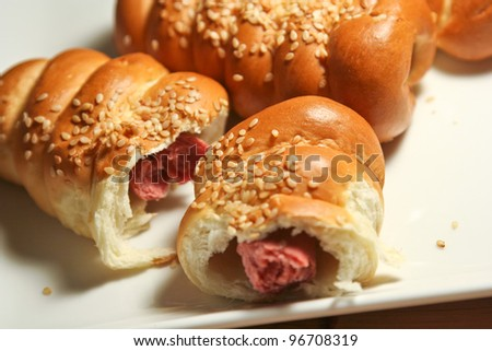 Fresh baked with sausage and sesame - stock photo