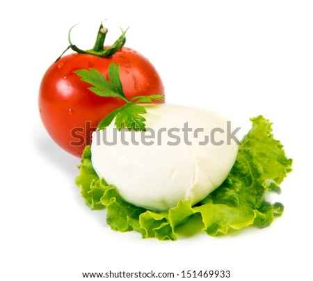 Fresh ball of mozzarella on lettuce leaf with tomato isolated over white - stock photo