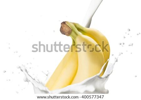 Fresh Banana Fruit Fall on Milk Splash - stock photo