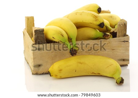 fresh bananas in a wooden crate on a white background - stock photo