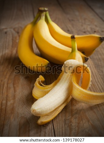 Fresh bananas on wooden background - stock photo