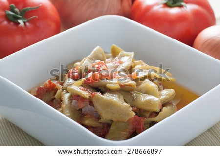 Fresh beans with tomato sauce cooked in Turkish style. Made with fresh beans, onions, garlic, tomato, olive oil and sugar.Served cold. - stock photo