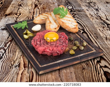 fresh beef tartar with egg - stock photo