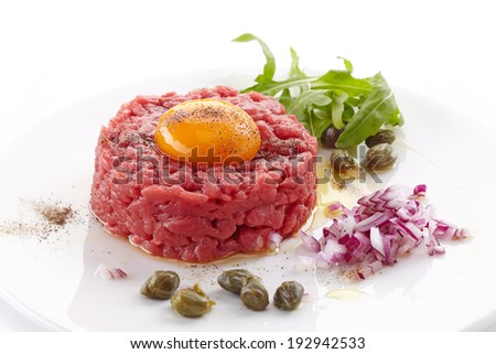 fresh beef tartare with egg on white plate - stock photo