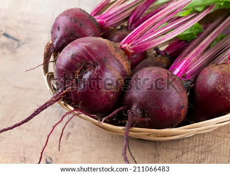 fresh beet on wooden surface - stock photo