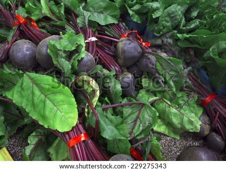 Fresh beets for sale at a farm market. - stock photo