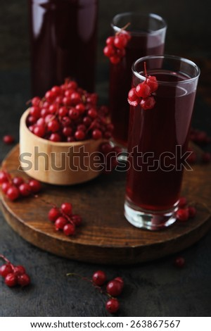 Fresh berries drink and bowl with frosty red currants - stock photo