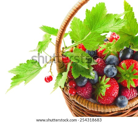 Fresh berries in the basket isolated on white background - stock photo