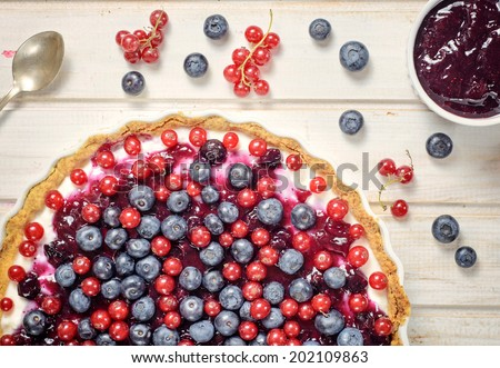 Fresh berries on the tart cake from above.Selective focus on the tart - stock photo