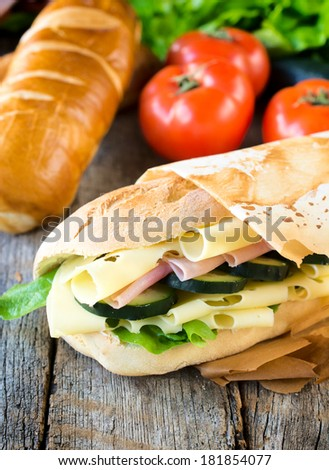 Fresh big sandwich with ham and cheese.selective focus on the sandwich  - stock photo