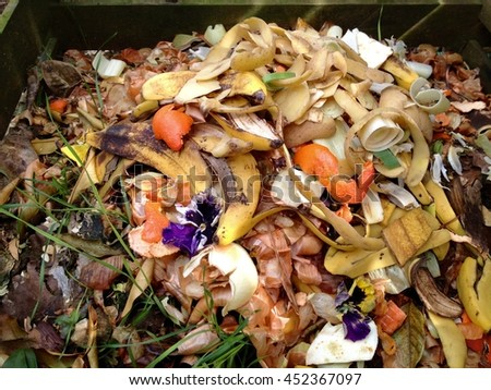 Fresh bio-waste and compost in the garden - stock photo