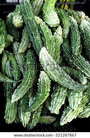 Fresh bitter gourds or karela in urdu language.  - stock photo