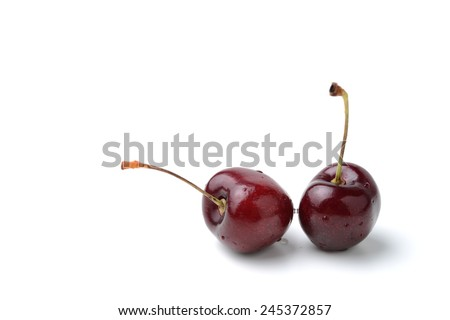 fresh black cherries isolated on white - stock photo