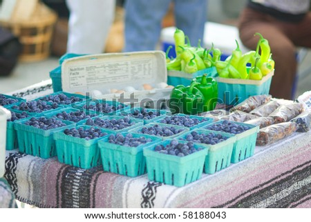 Fresh blueberries for sale at a farmers' market - stock photo