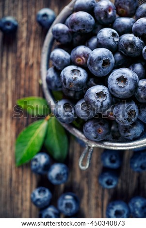 Fresh blueberries from organic cultivation on rustic wooden table, top view, close up - stock photo