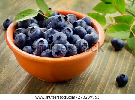 Fresh blueberries in a  bowl. Selective focus - stock photo